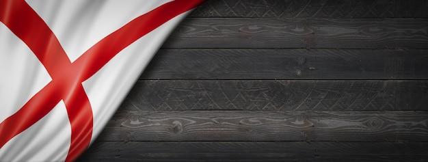 Bandeira do alabama na parede de madeira preta, eua. renderização 3d