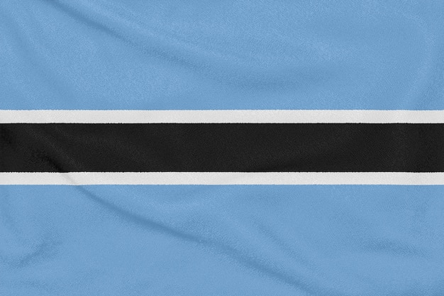 Bandeira do botswana em tecido texturizado. símbolo patriótico