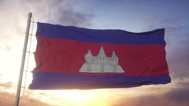 Bandeira do camboja balançando ao vento, o céu e o sol de fundo. renderização 3d.