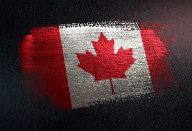 Bandeira do canadá feita de tinta pincel metálico na parede escura de grunge