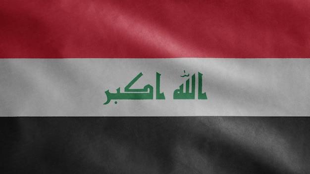 Bandeira do iraque balançando ao vento. close up da bandeira do iraque soprando em seda macia