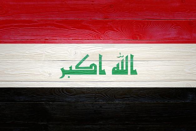 Bandeira do iraque pintada em pranchas de madeira