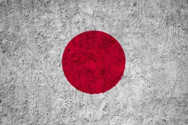 Bandeira do japão pintada na parede do grunge