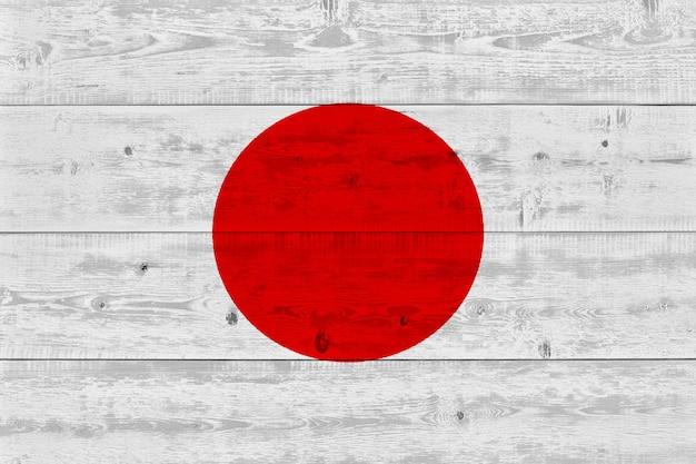 Bandeira do japão pintada na prancha de madeira velha