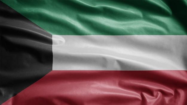 Bandeira do kuwait balançando ao vento. perto da bandeira do kuwait soprando, seda macia e suave. fundo de estandarte de textura de tecido de pano.