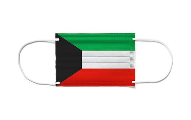 Bandeira do kuwait com máscara cirúrgica descartável