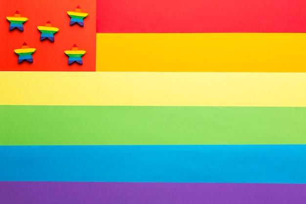 Bandeira do orgulho do arco-íris e estrelas coloridas