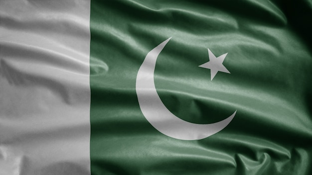 Bandeira do paquistão balançando ao vento. feche de modelo de paquistão soprando, seda macia e suave. fundo de estandarte de textura de tecido de pano.