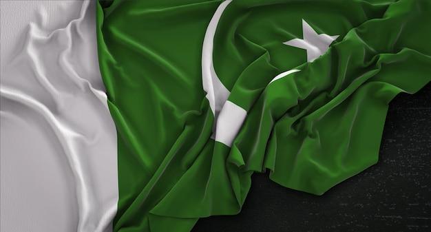 Bandeira do paquistão enrugada no fundo escuro 3d render