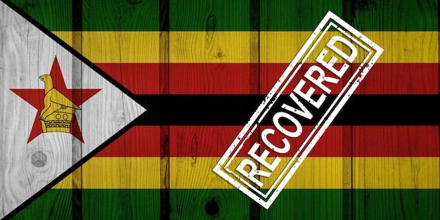 Bandeira do zimbábue que sobreviveu ou se recuperou das infecções da epidemia do vírus corona ou coronavírus. bandeira do grunge com selo recuperado