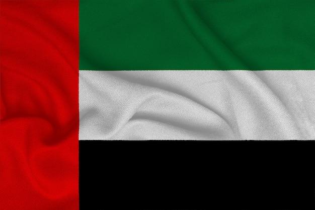 Bandeira dos emirados árabes unidos da fábrica de tecido de malha. planos de fundo e texturas.