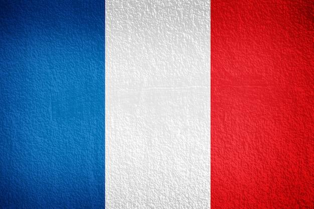 Bandeira francesa pintada na parede do grunge