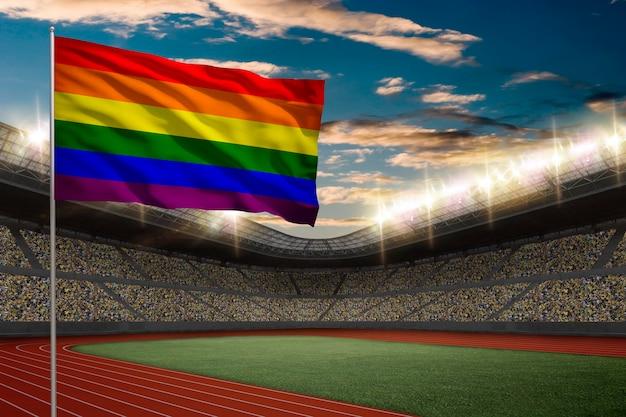 Bandeira gay em frente a um estádio de atletismo com fãs.