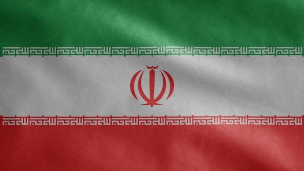 Bandeira iraniana balançando ao vento. perto da bandeira do irã soprando em seda macia.