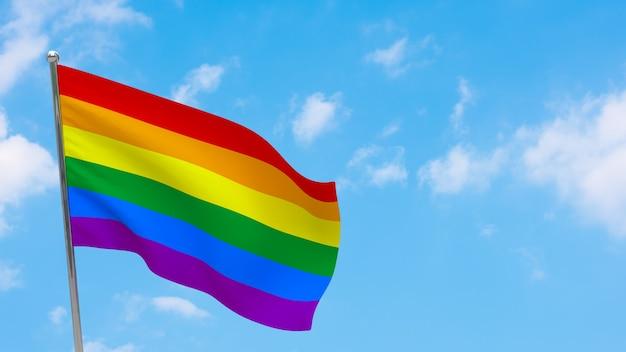 Bandeira lgbt no mastro. céu azul.