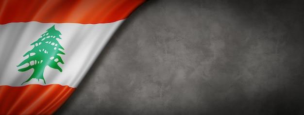 Bandeira libanesa no banner de parede de concreto