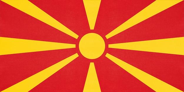 Bandeira nacional da macedônia tecido têxtil fundo, símbolo do país europeu do mundo