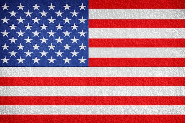Bandeira nacional dos eua no fundo da parede de pedra
