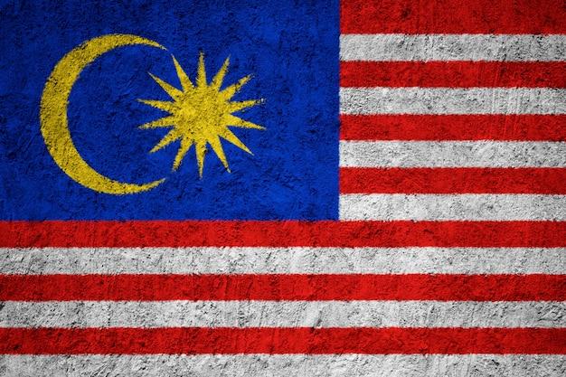 Bandeira nacional pintada da malásia em uma parede de concreto