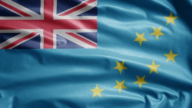Bandeira tuvaluana balançando ao vento. molde tuvalu soprado, seda macia e lisa. fundo de estandarte de textura de tecido de pano.