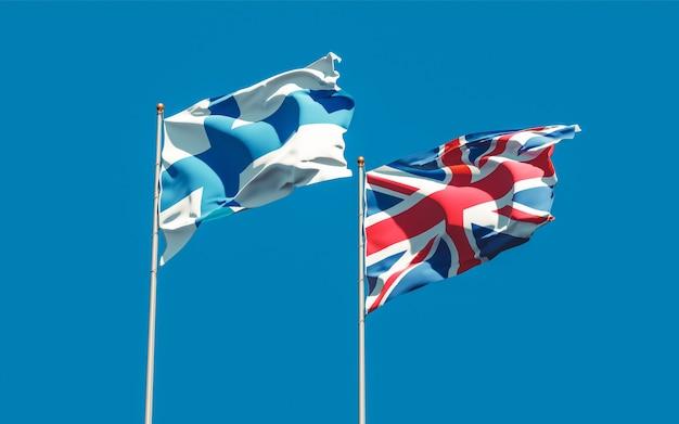 Bandeiras da finlândia e do reino unido britânicas no céu azul. arte 3d