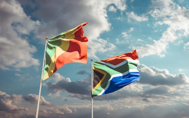 Bandeiras da república do congo e da sar africana no céu azul. arte 3d