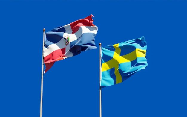 Bandeiras da suécia e da república dominicana no céu azul. arte 3d