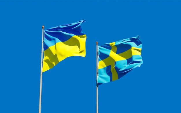Bandeiras da swedenraine e da suécia no céu azul. arte 3d