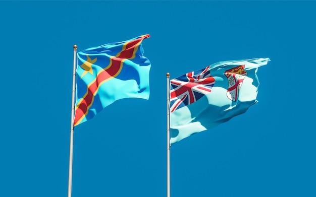 Bandeiras de fiji e da república democrática do congo no fundo do céu