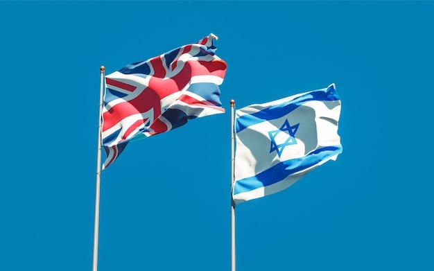 Bandeiras de israel e do reino unido britânicos no céu azul. arte 3d