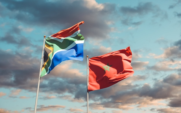 Bandeiras de marrocos e da sar africana no céu azul. arte 3d