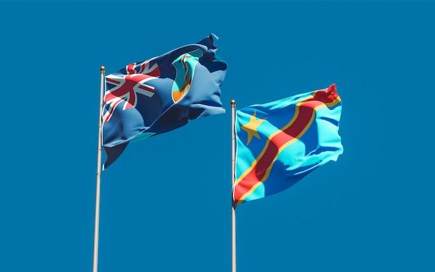 Bandeiras de montserrat e da república democrática do congo no céu azul. arte 3d
