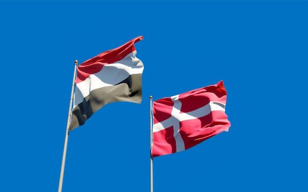 Bandeiras do iêmen e da dinamarca. arte 3d