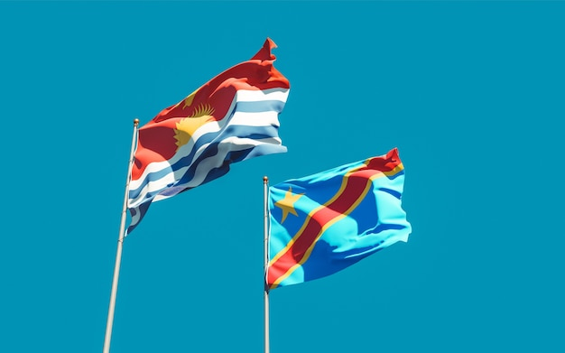 Bandeiras do kiribati e da república democrática do congo no céu azul. arte 3d