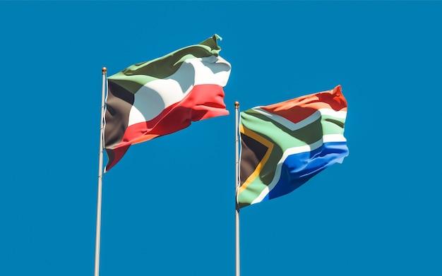 Bandeiras do kuwait e do sar africano no céu azul. arte 3d