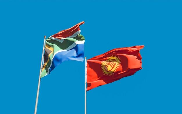 Bandeiras do quirguistão e do sar africano no céu azul. arte 3d