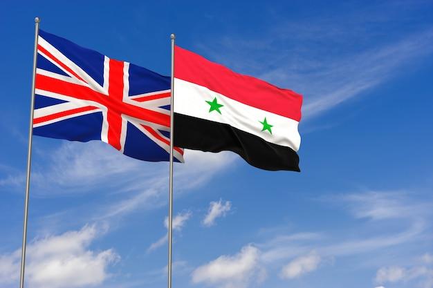 Bandeiras do reino unido e da síria sobre o fundo do céu azul. ilustração 3d