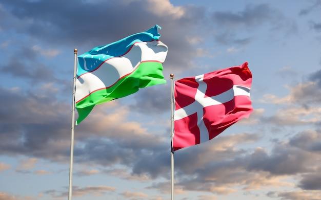 Bandeiras do uzbequistão e da dinamarca. arte 3d
