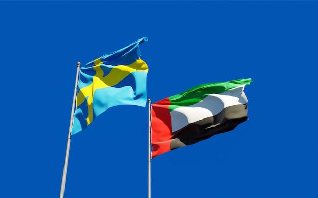Bandeiras dos emirados árabes unidos, suécia e suécia no céu azul. arte 3d