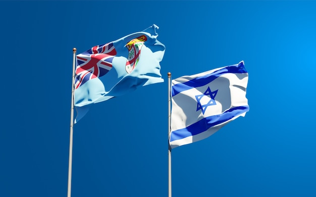 Bandeiras estaduais de fiji e israel juntas no fundo do céu