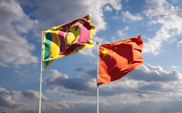 Bandeiras estaduais nacionais do sri lanka e da china juntas