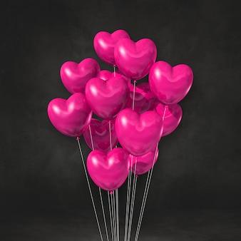 Bando de balões de forma de coração rosa em um fundo de parede preta. ilustração 3d render