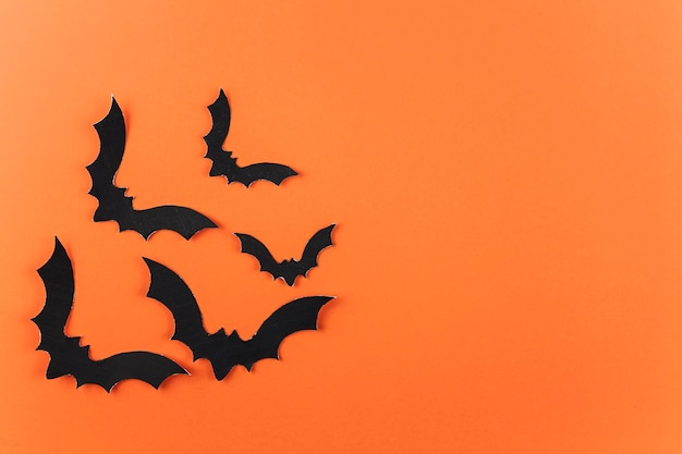 Bando de morcegos de papel preto