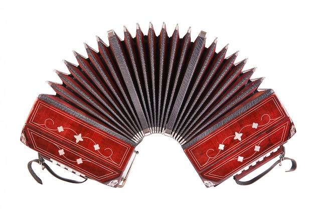Bandoneon, instrumento de tango, vista frontal, isolado no branco