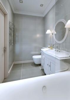 Banheiro em estilo art déco com piso de cerâmica cinza no piso e nas paredes