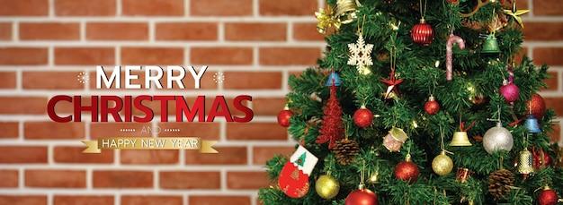 Banner de feliz natal e feliz ano novo para a capa ou capa do site de mídia social ou decoração de página de fã. foto de ornamentos decorativos com texto de natal e letras com fundo de parede de tijolo.