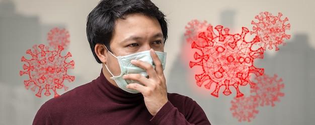 Banner do homem asiático usando máscara contra a poluição do ar e o vírus corona