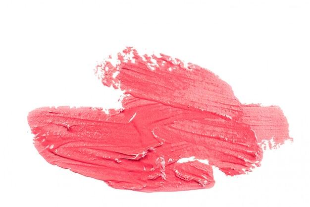 Batom vermelho sobre fundo branco