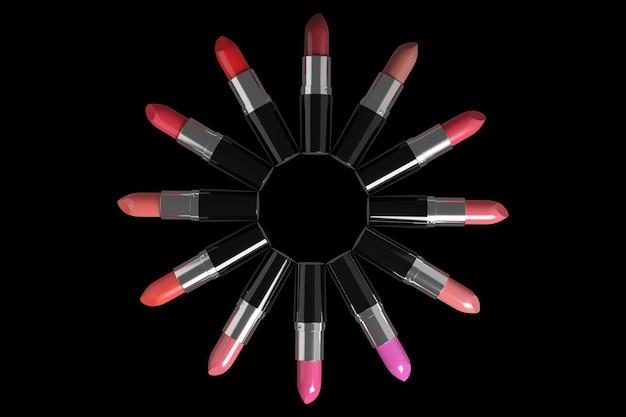 Batons de cores diferentes, dispostos em um círculo na superfície preta.