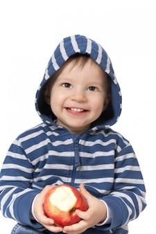 Bebê com maçã vermelha